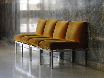 Mustard chairs empty in lobby