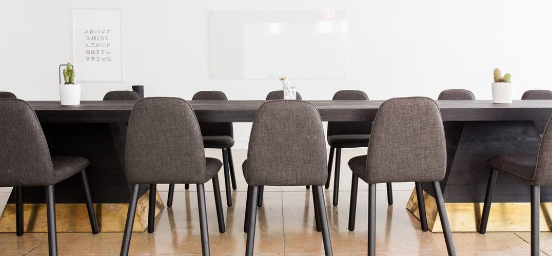 Grey empty chairs at conference table